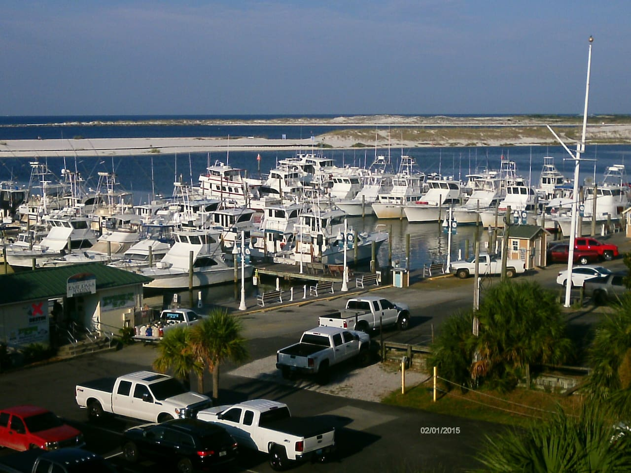 view from our building, the boardwalk, harbor, inlet, and Gulf of Mexico