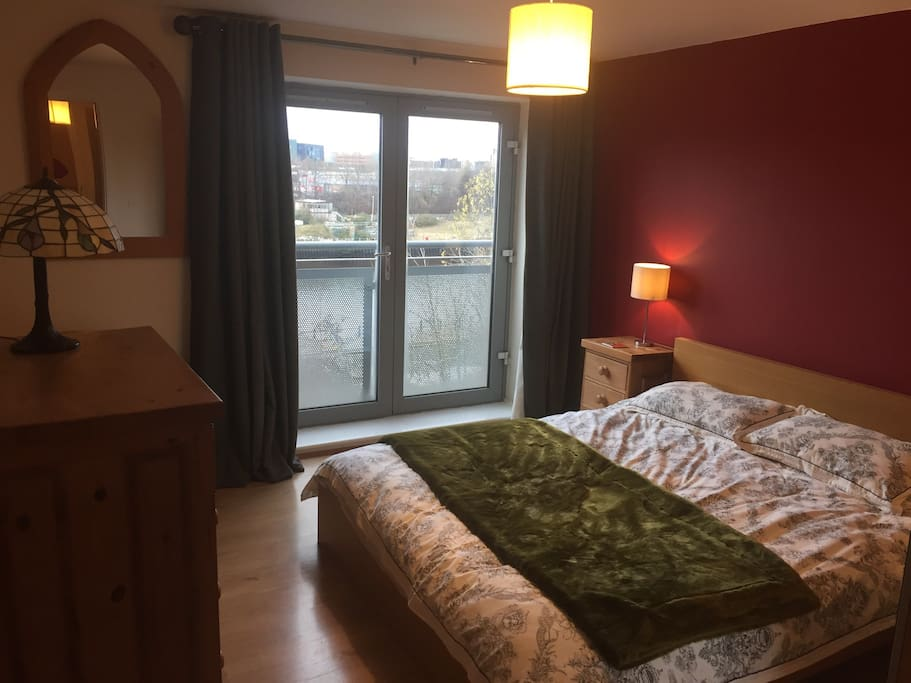 Comfortable bedroom with views on to the river.