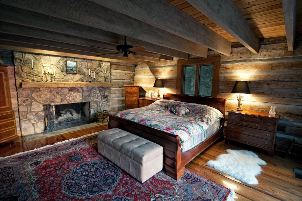 The Master's Suite with King Sleigh Bed and fieldstone fireplace