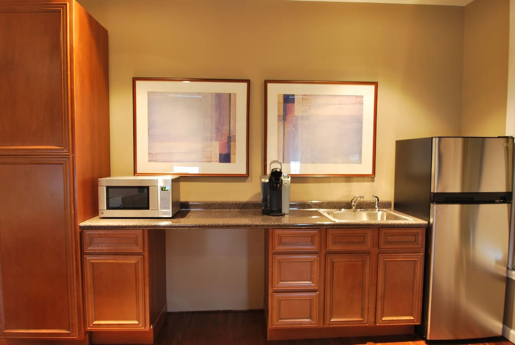 Kitchenette with microwave, keurig coffee maker, fridge / freezer.
