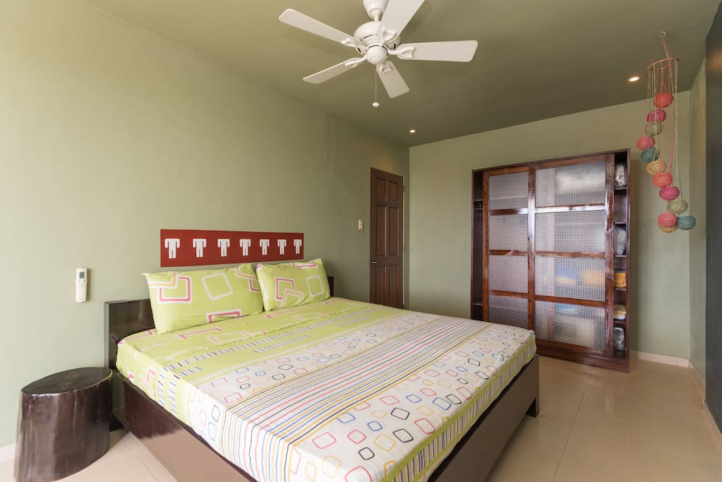 Spacious bedroom with sea view, king size bed and mattress, remote controlled a/c,  ceiling fan with dimming lights, wardrobe with safe big enough for laptop.
