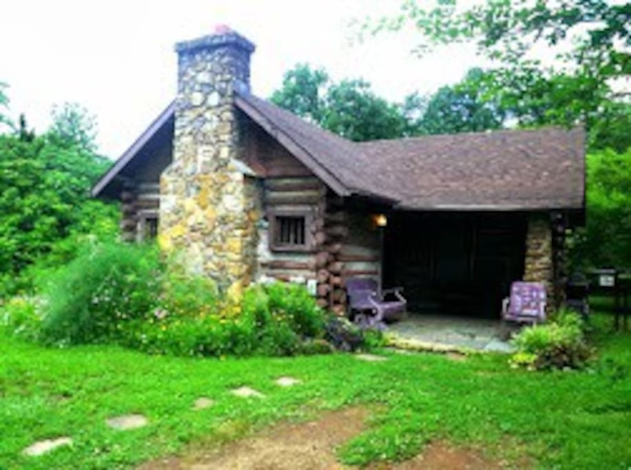 This private cabin is cozy and charming, with interesting features like the rock chimney and slate entry porch.