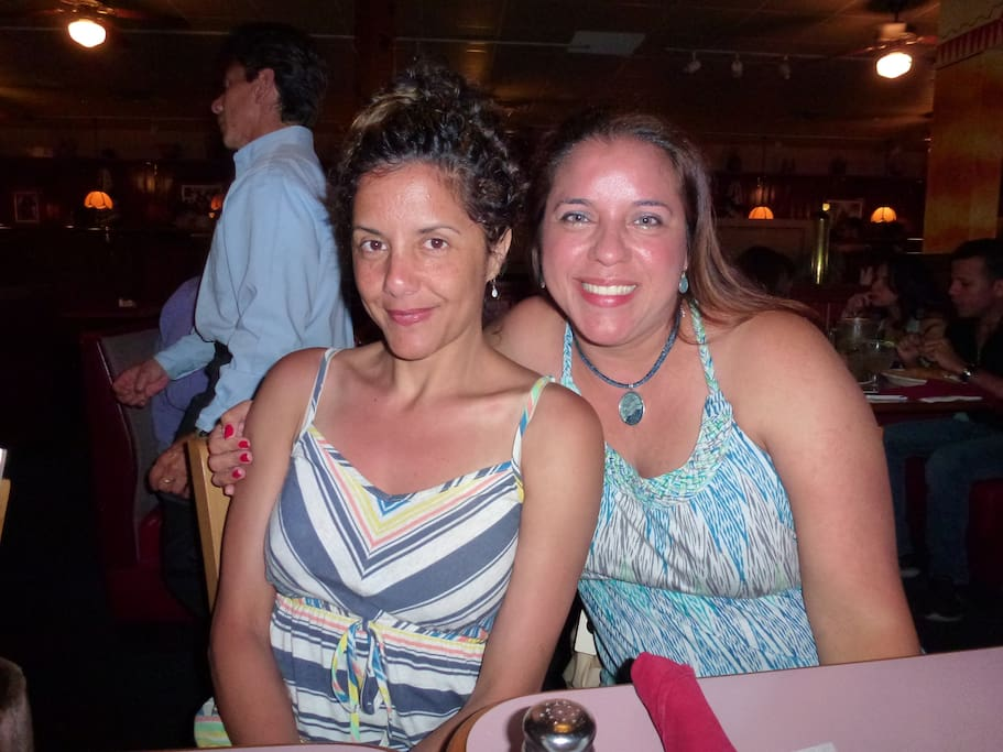 You host on left with striped summer dress. Self with cousin in Florida this Summer.