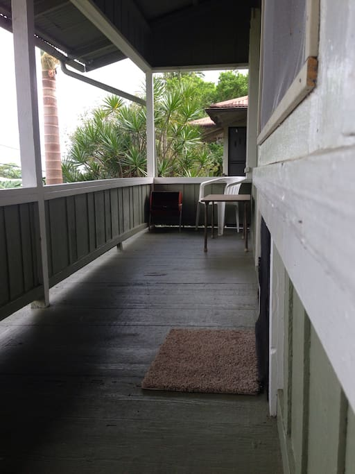 This long porch is where you can sit and relax or BBQ.