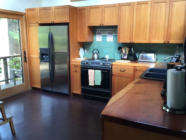 The kitchen is very well stocked and has many appliances large and small