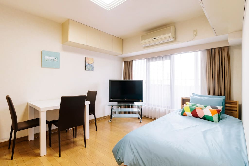 Sunny living room in vibrant area with 1 single bed