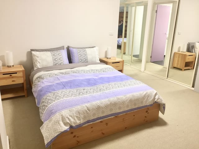 Queen sized bed in the Master bedroom with plenty of hanging space and room for luggage