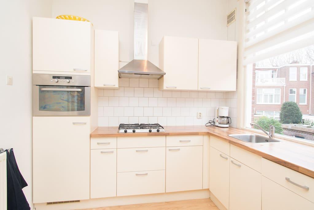 Open plan kitchen with fridge, dishwasher