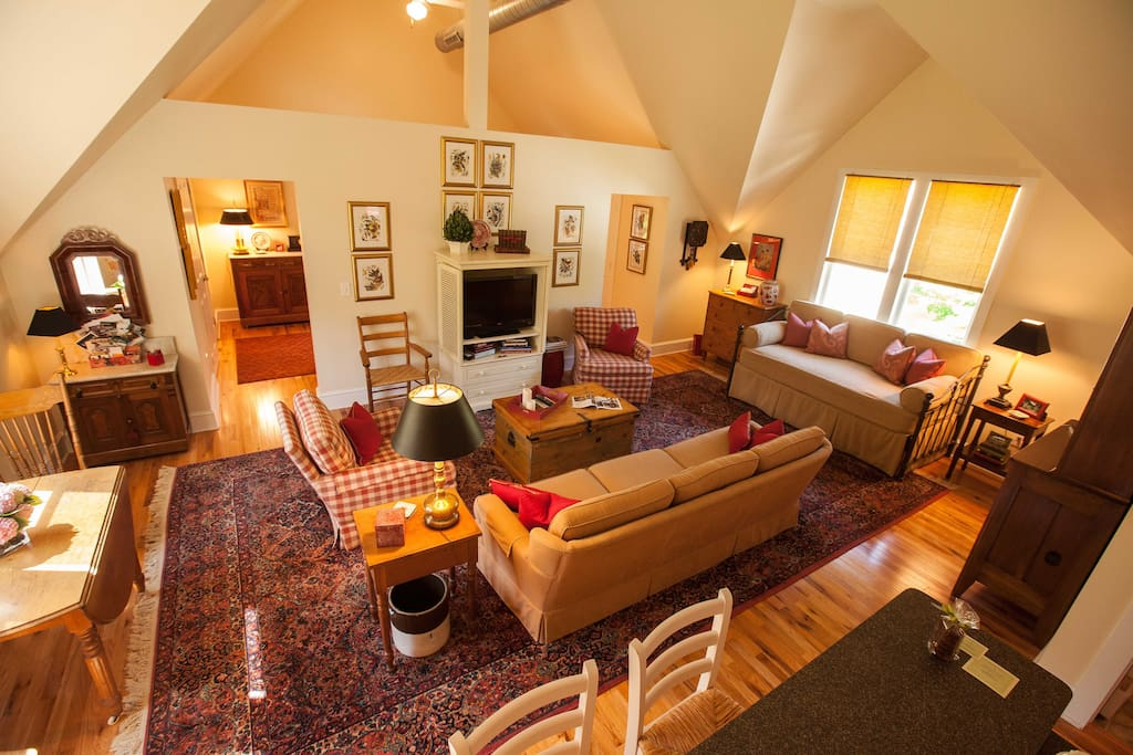 The guest house great room has distinctive architectural features and soaring 17 foot ceilings.