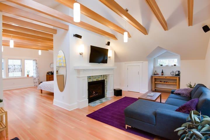 Top floor loft with fireplace