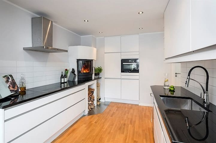 Kitchen, enjoy the fireplace for extra coziness