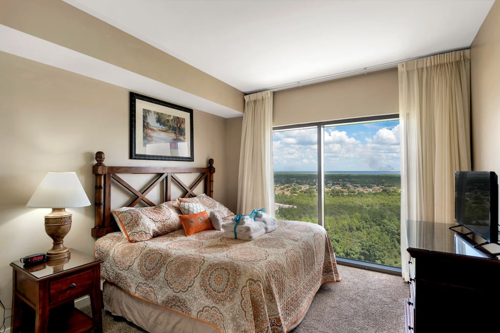 The Guest Bedroom features AMAZING views, a King bed, flat screen TV and private access top the guest bath