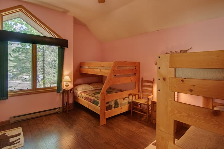 Bedroom 2, two bunk beds, one full bed, three twin beds