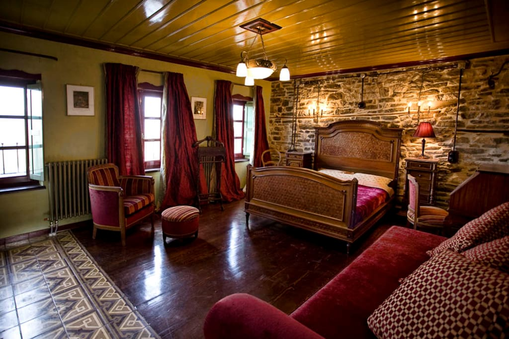 The biggest room, our suite with the 4 windows and the old tiles!