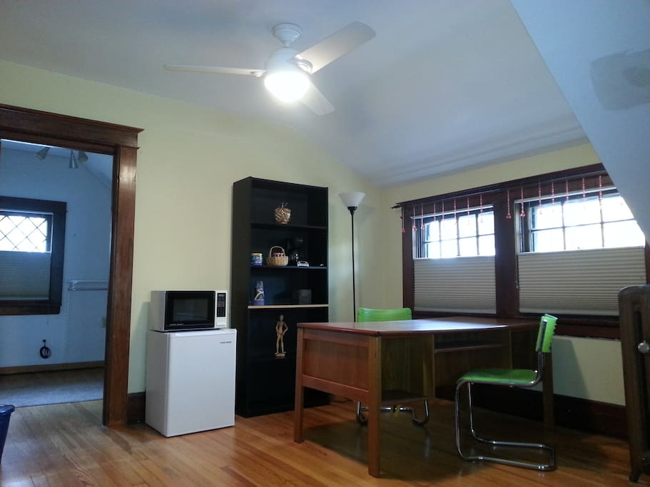 sitting room with kitchenette amenities