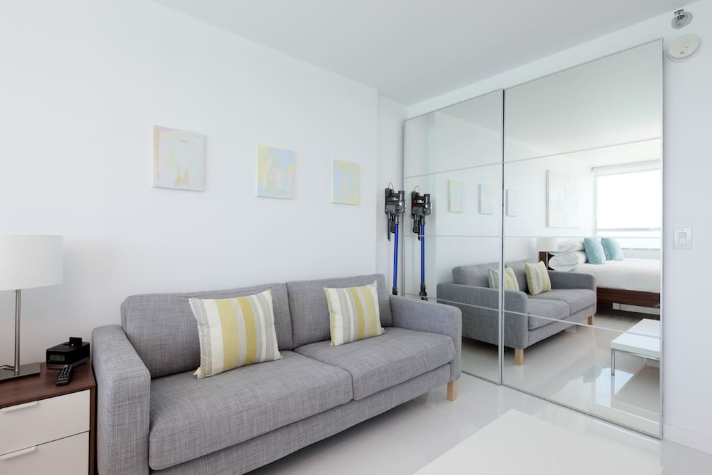 Comfortable Sofa with huge wall to wall mirrors that reflect the 180 degree ocean views