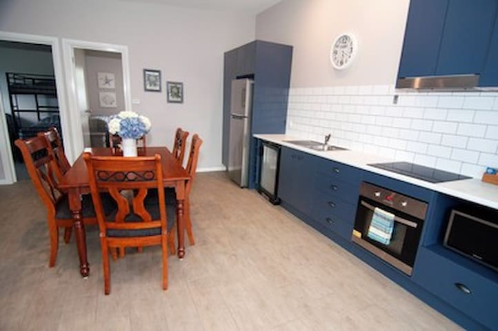 Large easy to use kitchen with additional bar fridge. All cutlery, pots, pans, toaster etc is provided.