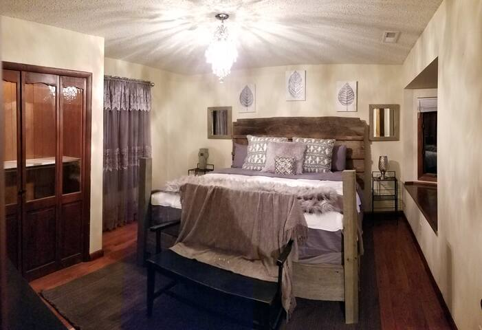 King-sized handmade bed complete with original closet doors and bay window