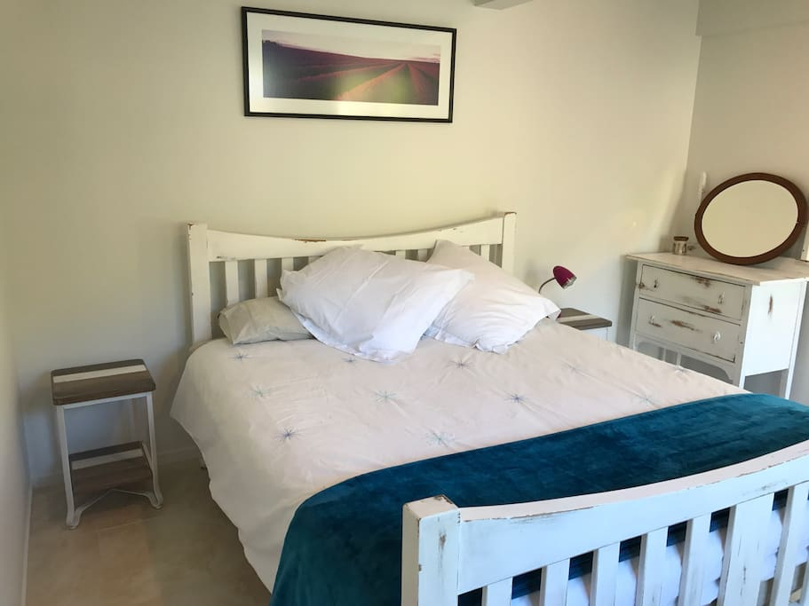 Your King Size bed awaits with clean crisp linen, soft underlays and European pillows for reading - keep cosy in the winter with electric blanket and heater in your room
