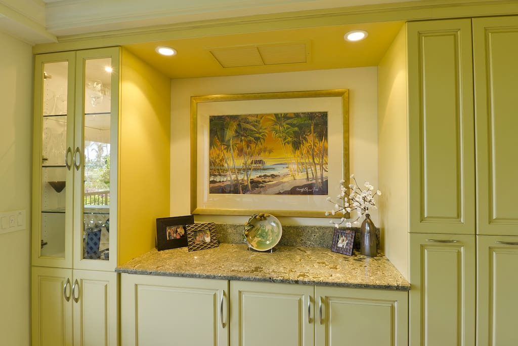 Extended kitchen with bar refrigerator and pull out pantries