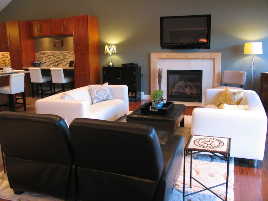 Comfortable living room with fireplace and 50 inch plasma TV