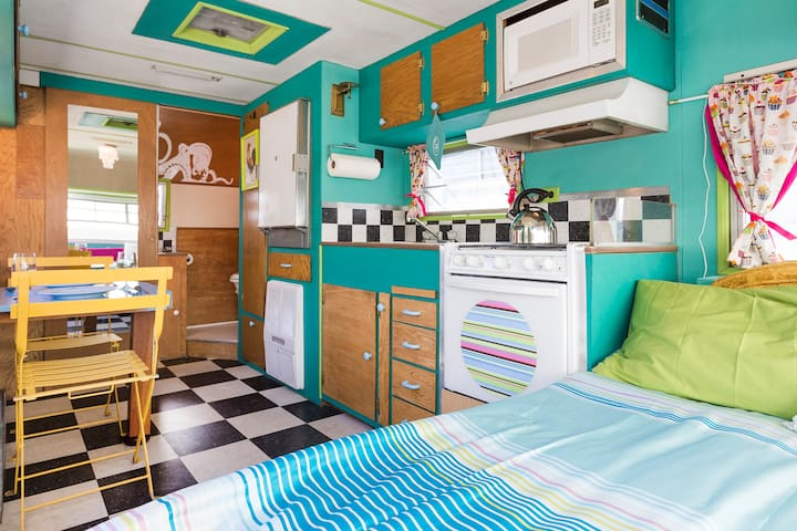 Custom layout with a more spacious interior than you'll find in most other trailers.  It's quite nice!