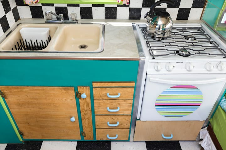 Kitchen with gas range, microwave, double sink and fridge