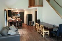 Great room with rustic dining table, handmade from recycled wood, (comfortably seats up to 10 people)