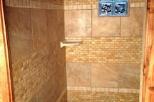 We finished the shower! Spacious, custom tile, glass block windows for extra light!