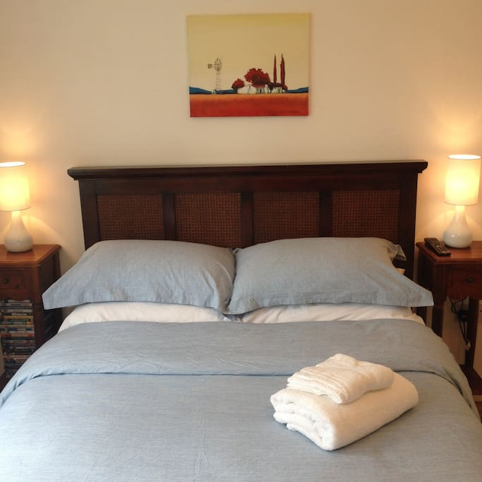 Double bed, firm mattress, Egyptian cotton bedding, luxury micro fibre duvet, black-out blind.
