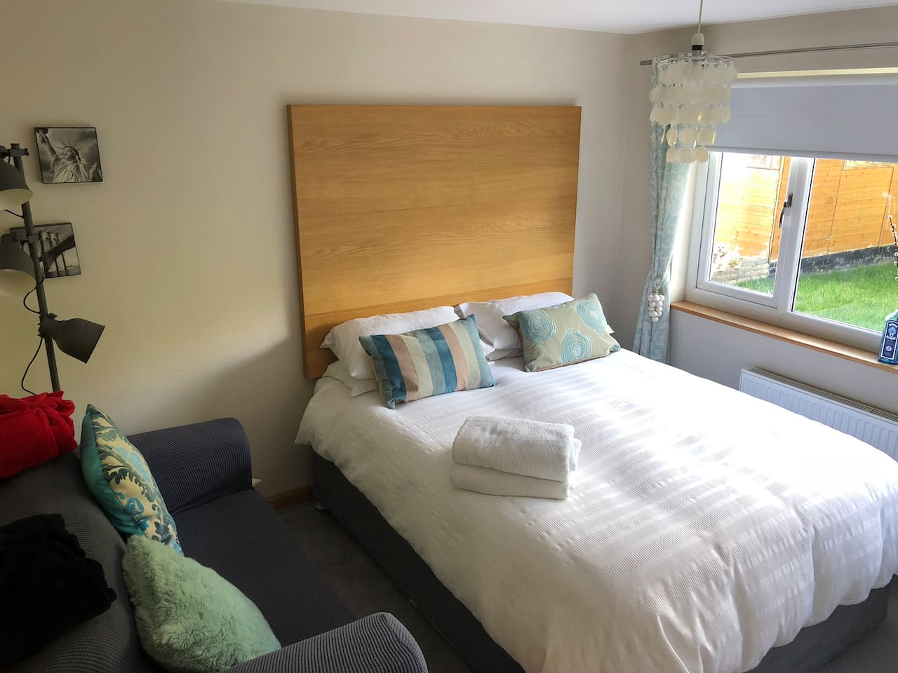 Comfy  Bright and Airy Double bedroom  with gas central heating  Fab  King Sized Bed - Freeview Tv Sofa and Table for laptop/eating etc  - Door has lock for your privacy  - In summer we dont have heating on but there is a portable heater in kitchen