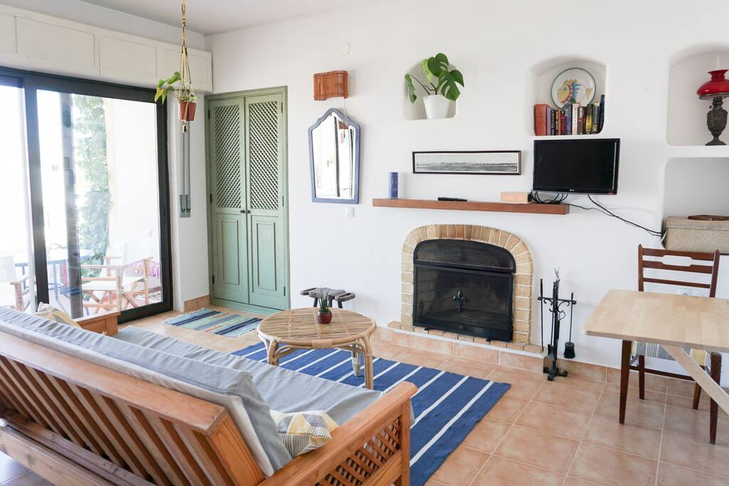 Bright living room with a big window-wall. Cable TV and Internet WIFI are provided. We welcome a book exchange - leave yours and pick a new one to read.