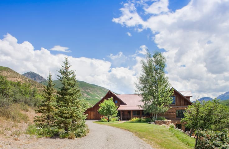 Classic Fieldstone & Log Mountain Residence