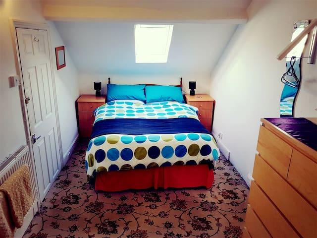 Quirky double Victorian attic bedroom