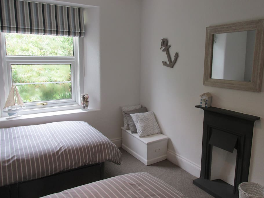 Newly decorated room with new carpet and beds