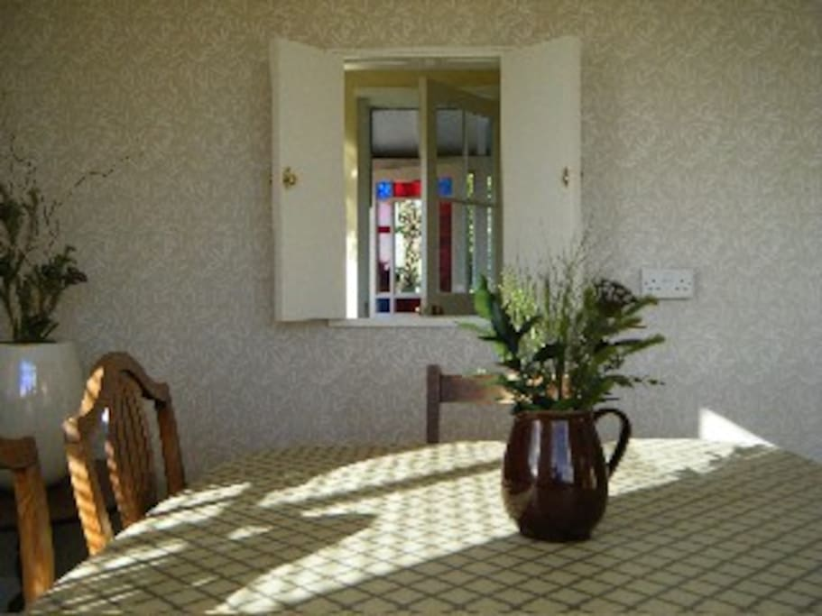 The sunny breakfast/dining room has a hatch through to the kitchen.