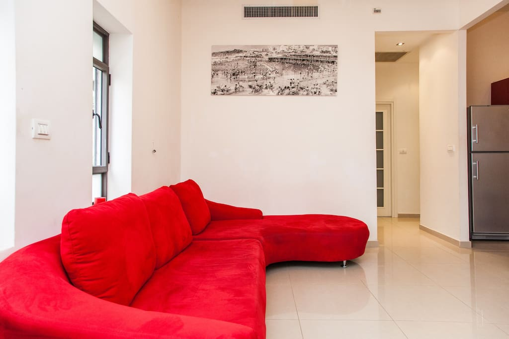 nice cosy living room with our famous red sofa