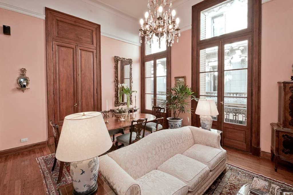 Formal living-dining room with French doors leading to the balconies