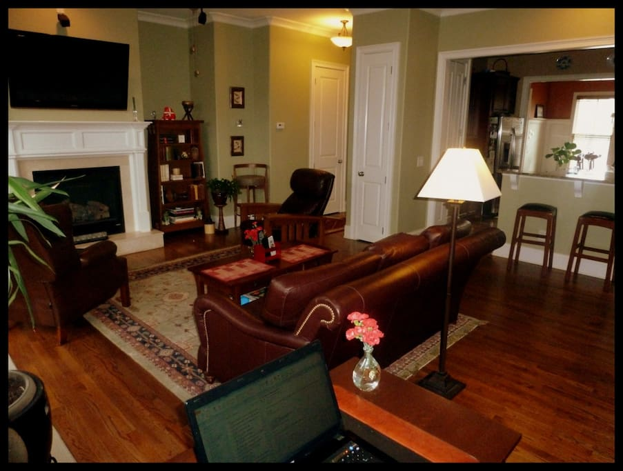 Cozy living/family room with fireplace, 50' screen tv, stickley furniture...