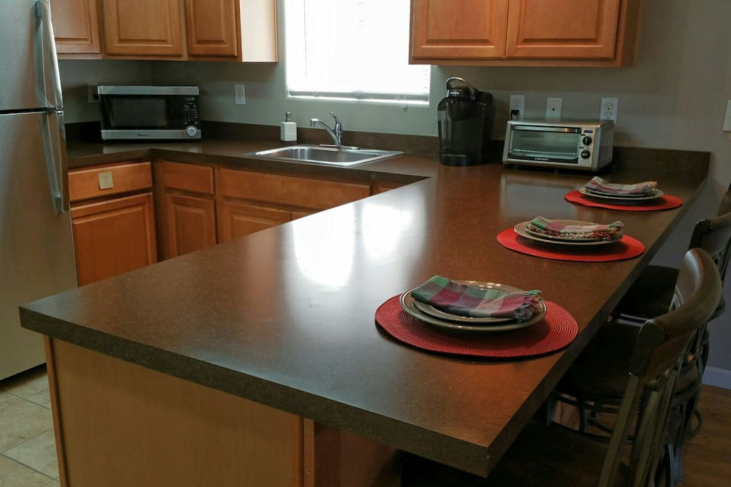 Spacious and organized kitchen provides a full fridge with ice maker in the freezer, microwave, toaster oven and Keurig coffee maker with a variety of coffee and teas to choose from.