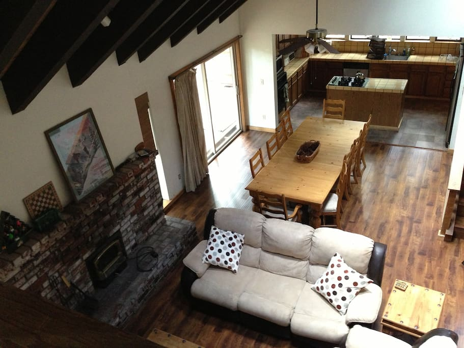 Great room with recliner sofa and a 10-person dining table