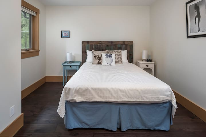 Spacious queen-sized bedroom with a large closet and hotel quality linens