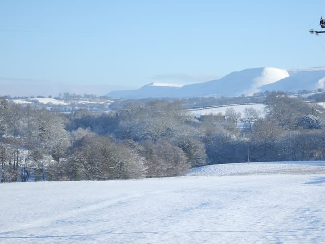A winter view of the Black Mountains from Newhouse. Working from the far distance you see Hay Bluff, Lord Hereford's Knob, also known as Twmpa and Y Das. We often choose to walk these hills, rather than the Beacons, being less known and not so busy.