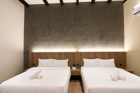 Two queen size beds are available in the room, perfect for family who'd like to explore Melaka that is full of historical attractions.