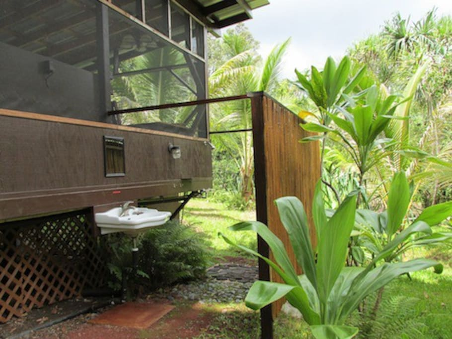 Outdoor shower and sink are below cabin.