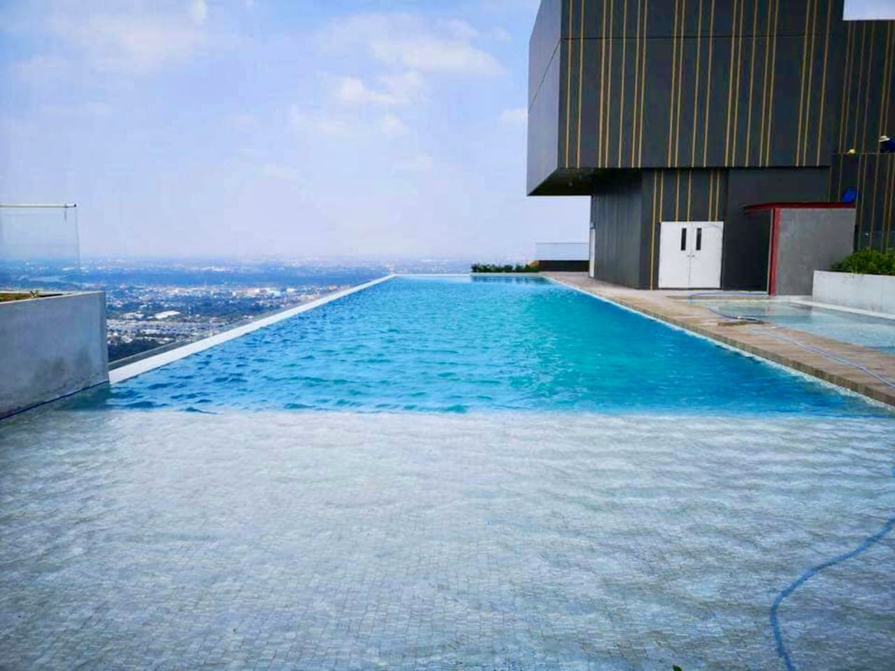 Rooftop outdoor swimming pool with panorama view on 56th floor.