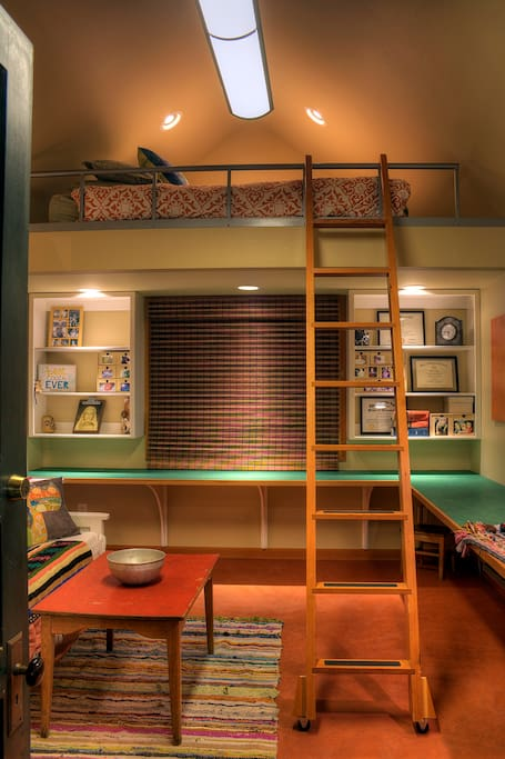 Ladder to a queen size loft bed that sleeps 2.