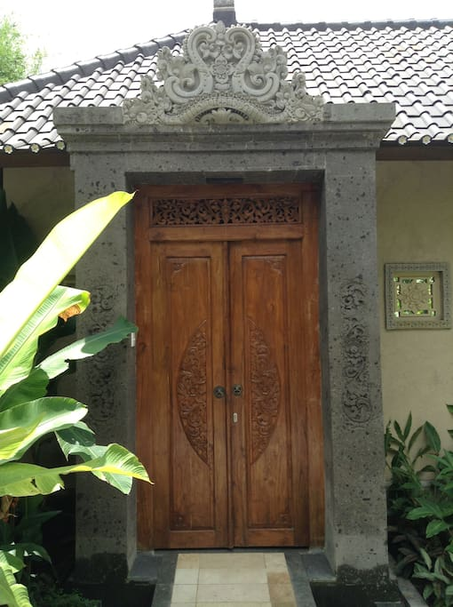 Beautiful hand carved stone and wood entrance to Villa Laba Puseh.