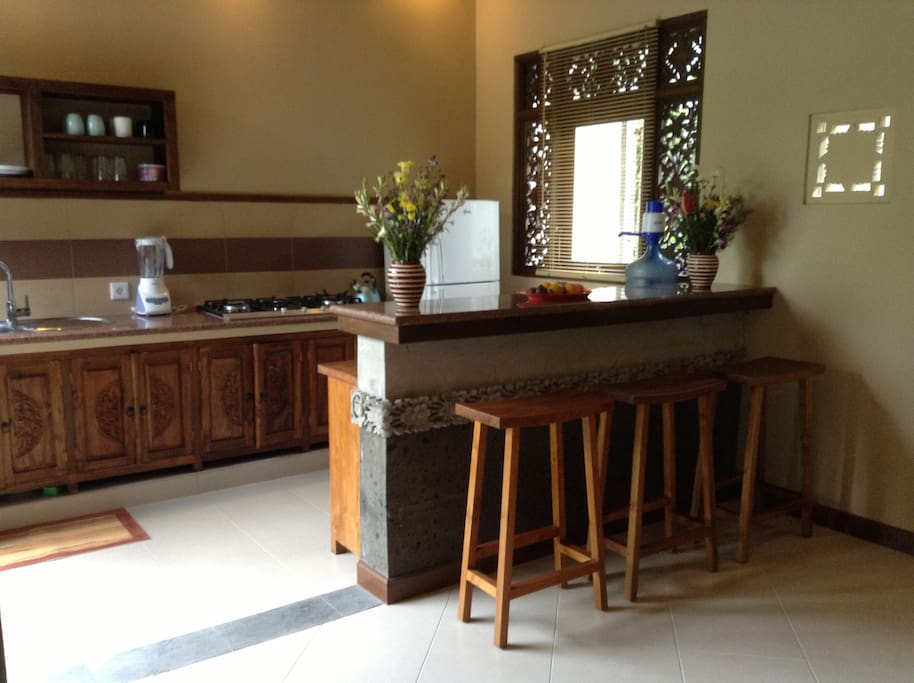 Kitchen and bar area, complete with hand carved wood and stone accents.