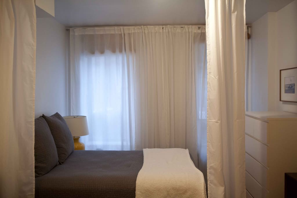 a curtain allows you to separate the sleeping area from the living area